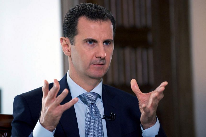 President Bashar al-Assad speaking to a journalist with Russia's RIA Novosti state news agency in the Syrian capital Damascus.