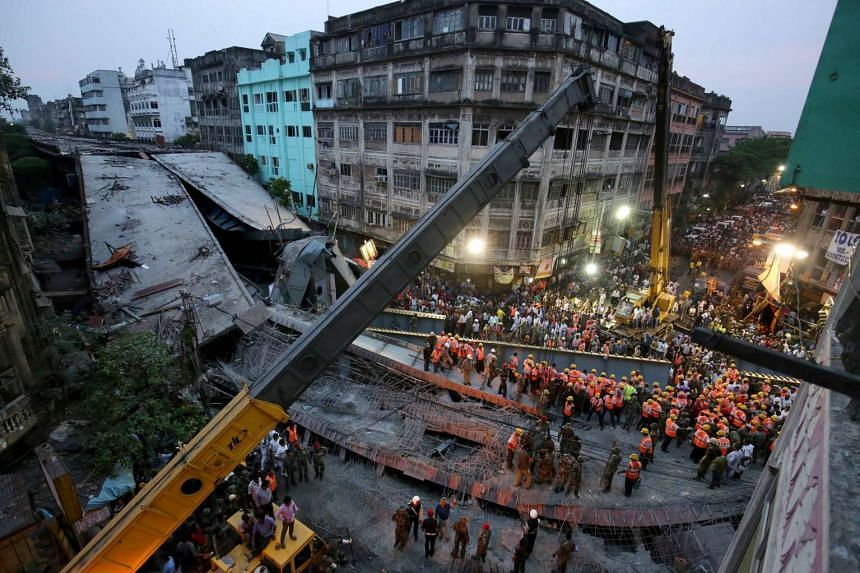 National Disaster Response Force and Indian army personnel search for victims after the collapse of a flyover in Kolkata, India, on March 31, 2016.