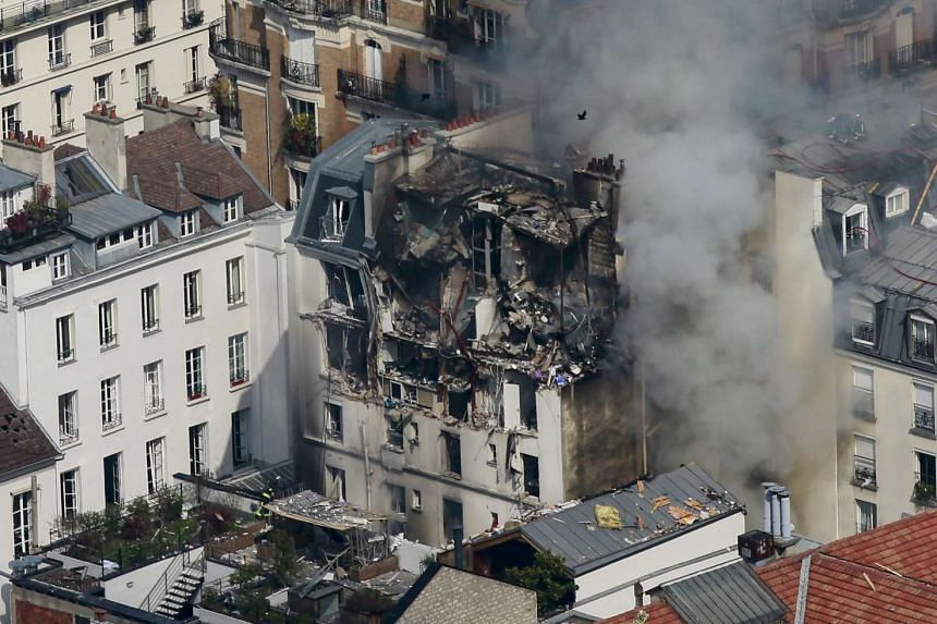 The blast destroyed the top floors and roof of a residential building and injured 17 people.