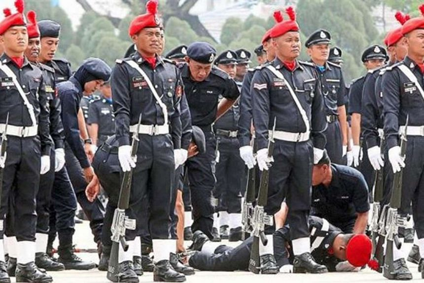 The heatwave in Malaysia took its toll on some of the policemen taking part in the 209th Police Day celebrations on March 25.