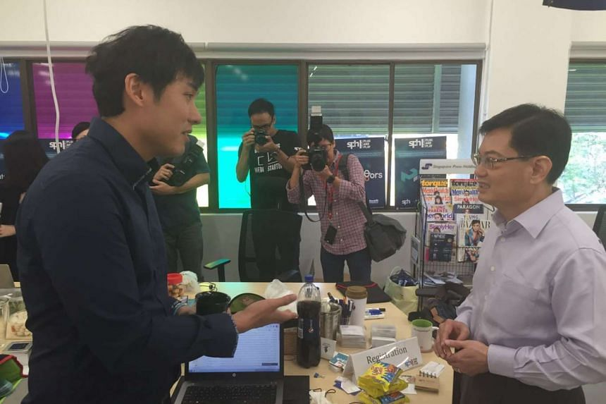 Finance Minister Heng Swee Keat (right) speaking to Mr Rudy Lim, manager of the SPH Media Fund, during his tour of a start-up co-working space at JTC LaunchPad @ one-north on Friday (April 1).