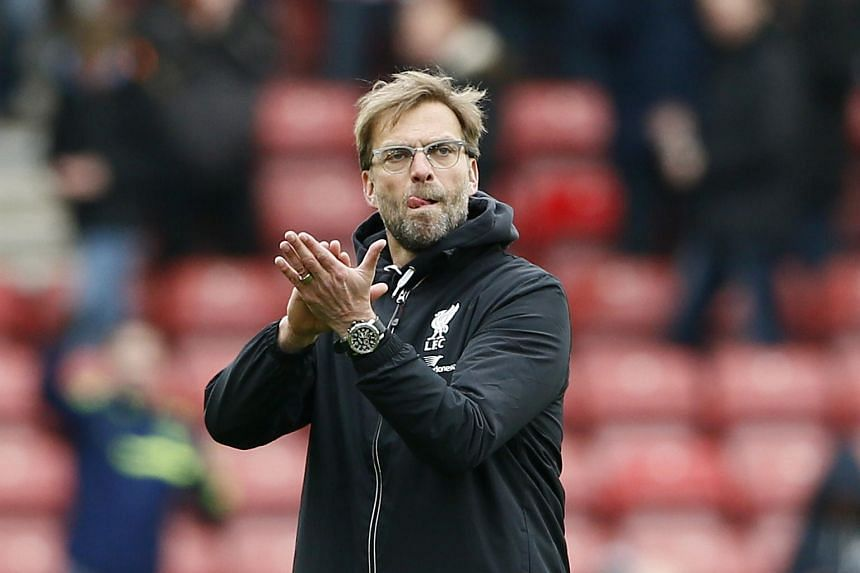 Liverpool manager Juergen Klopp aplauds the fans at the end of the game on March 20, 2016.