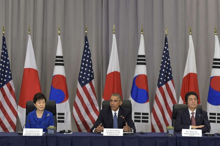 Obama with South Korea's Park Geun-Hye (left) and Japan's Shinzo Abe on the sidelines of the Nuclear Security Summit.