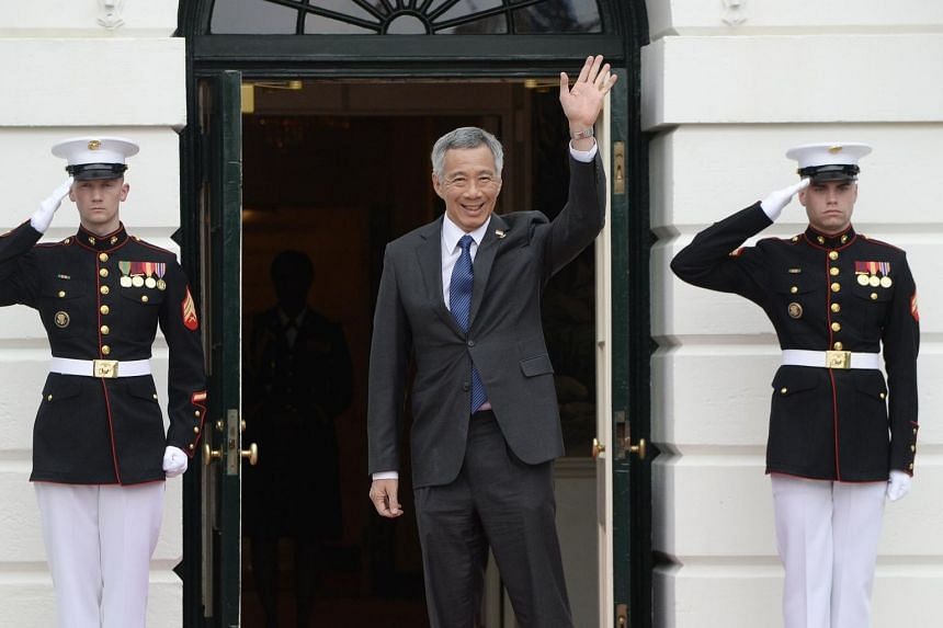 Singapore Prime Minister Lee Hsien Loong arrives for a working dinner at the White House, on March 31, 2016 in Washington.