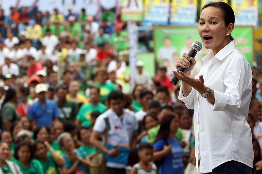 Philippine senator Grace Poe (right) greeting supporters during a political campaign in the town of San Nicolas, Philippines, on March 30, 2016.
