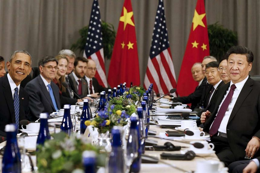 US President Barack Obama (left) meets with Chinese President Xi Jinping (right) at the Nuclear Security Summit in Washington, on March 31, 2016.