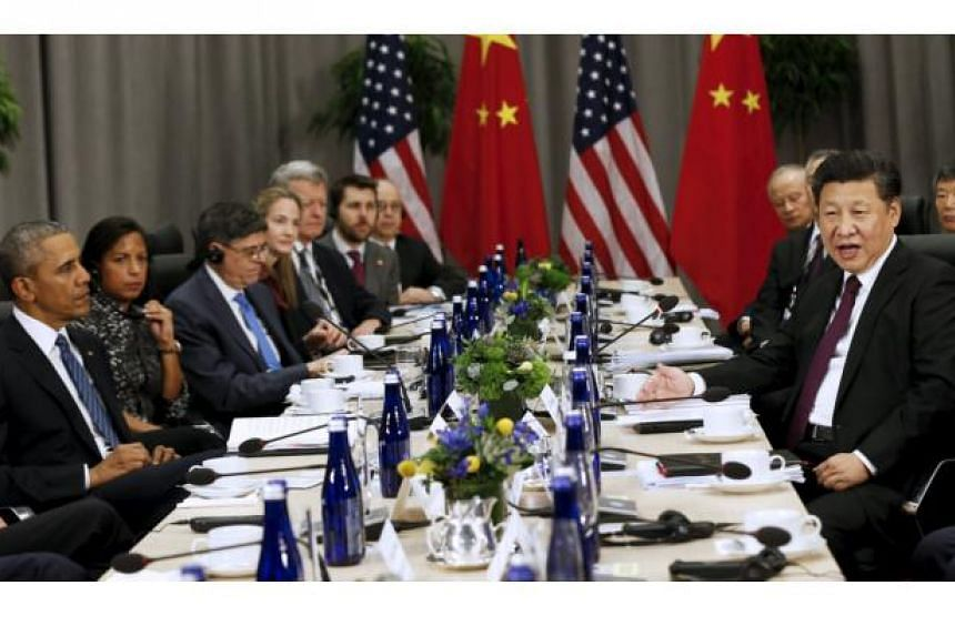 US President Barack Obama (left) meets with Chinese President Xi Jinping (right) at the Nuclear Security Summit in Washington on March 31, 2016.