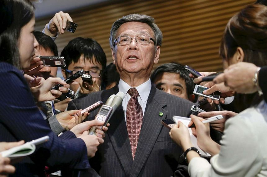 Okinawa Governor Takeshi Onaga (centre) speaking to reporters after a meeting with Japanese Prime Minister Shinzo Abe on March 4, 2016.