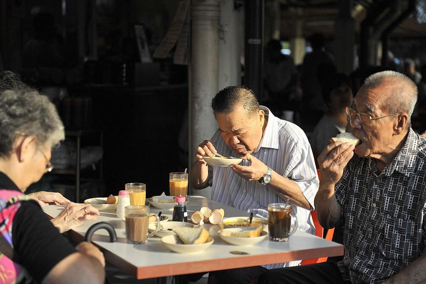 Senior citizens having breakfast at a coffeeshop in Punggol.