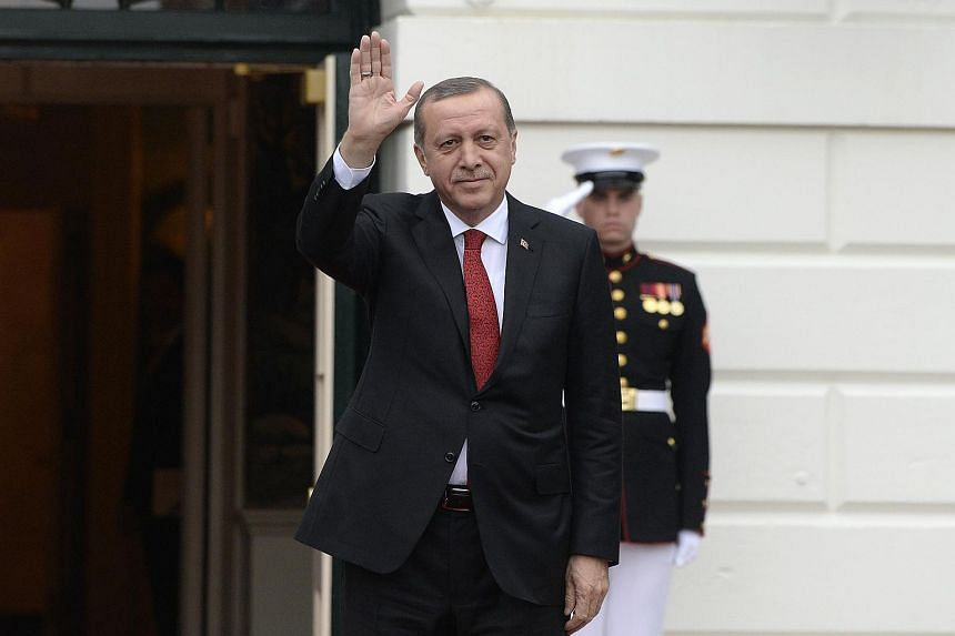 Turkey's President Recep Erdogan arrives for a working dinner at the White House in Washington, on March 31, 2016.