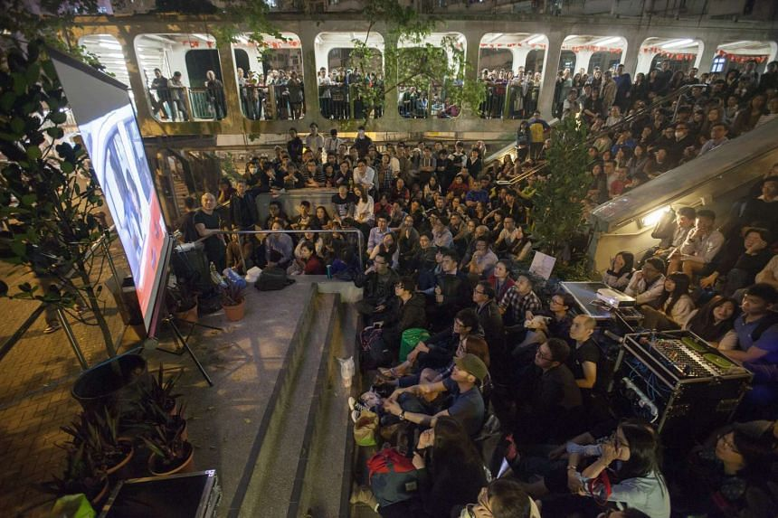 A crowd watches a community screening of the movie Ten Years on April 1, 2016, in Hong Kong.