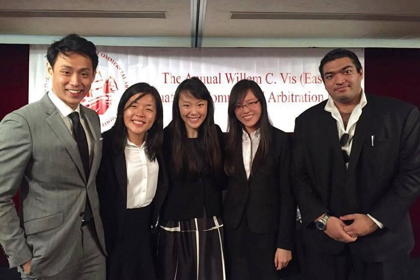 The Singapore Management University team for the Williem C. Vis (East) competition held in Hong Kong comprises (from left) Sean Sim Zhi Quan, 23, Kim Shi Yin, 23, Ni Qian, 21, Beatrice Wee, 21, together with coach Deya Dubey (right). They went up aga