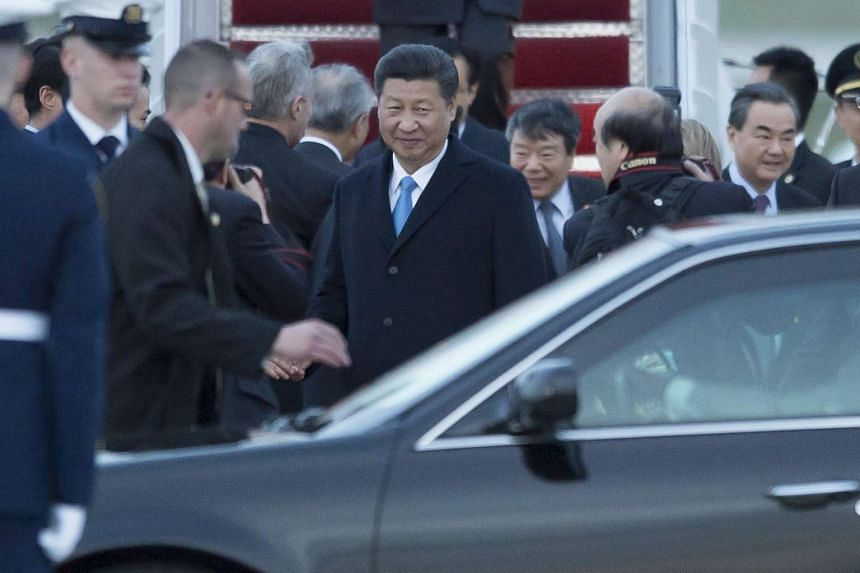 Chinese President Xi Jinping (centre) arrives for the nuclear summit on March 30, 2016.