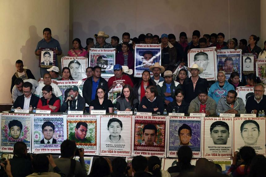 Relatives of the 43 missing students and members of the Argentine Team of Forensic Anthropology (EAAF) hold a press conference on Feb 9, 2016.