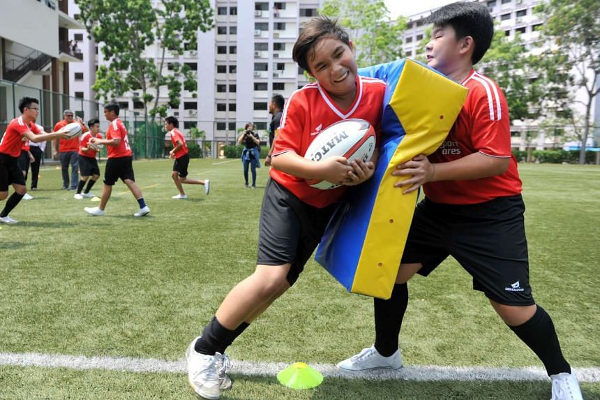 East Spring Secondary School students practising tackling in a rugby training session on March 31.