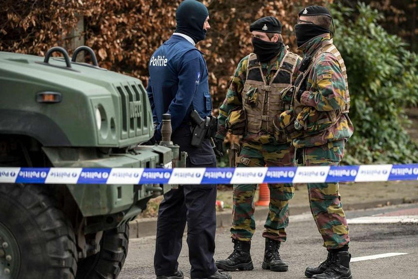 Belgian police and servicemen during a raid on a hotel and restaurant in Courtrai on March 31, 2016, linked to a foiled attack plot in France.