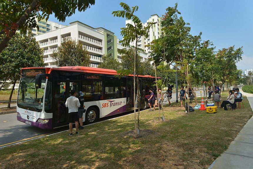 An SBS Transit bus mounted with a camera on the driver's side for the shooting of LTA's new promotional video.
