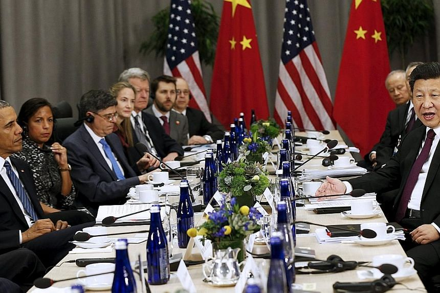 US President Barack Obama (left) meeting his Chinese counterpart Xi Jinping at the Nuclear Security Summit in Washington on Thursday. After the summit, leaders are expected to outline steps forward and issue action plans.