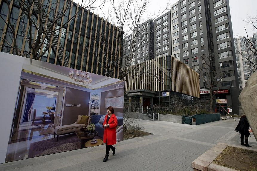 A property advertisement outside luxury apartment blocks in central Beijing. A new survey showed average prices in China's 100 biggest cities rose 7.4 per cent last month over the same period last year, the eighth year-on-year rise in a row.