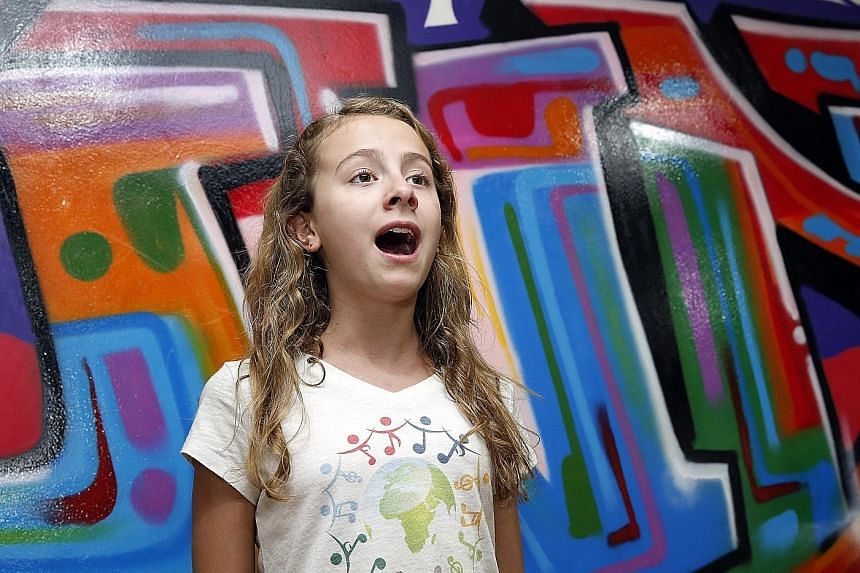 Capri is visiting 80 countries to sing their national anthem to raise funds.