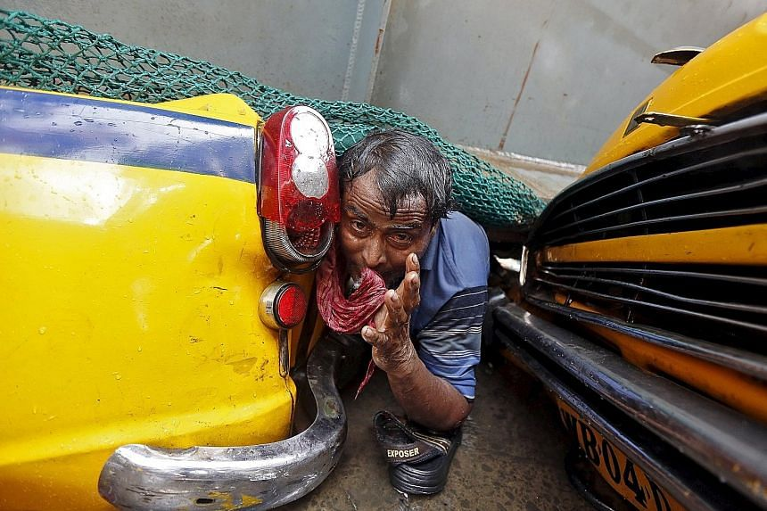 A man trapped amid the debris of a Kolkata flyover after it collapsed on Thursday. Rescuers have pulled out about 100 survivors, but hopes are fading of finding more.