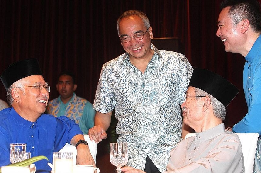 From left: Mr Najib, Mr Nazir, former Malaysian PM Abdullah Ahmad Badawi and his son Kamaluddin Abdullah at a Hari Raya event last year.