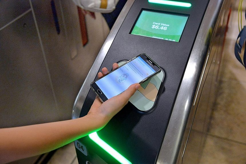 Commuters can now tap their compatible smartphones at card readers to pay for bus and train rides.