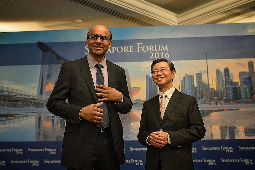DPM Tharman with former DPM Wong Kan Seng at the Singapore Forum attended by about 250 business leaders, politicians and thought leaders. Mr Wong chairs the forum's advisory board. Mr Tharman, who elaborated on the productivity situation in Singapore