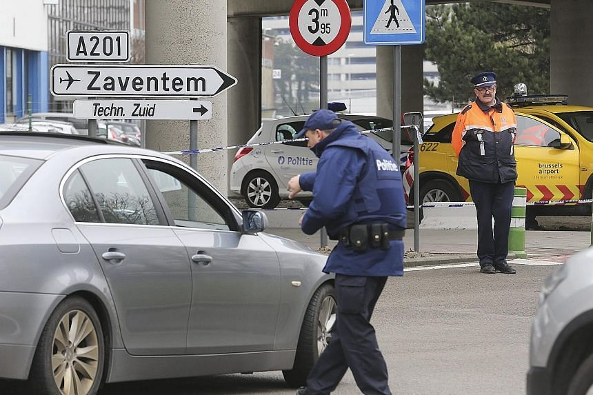Police checking vehicles at the entry to Brussels Airport. A police union chief in Belgium has warned of a serious security problem at the airport, citing systematic security flaws and the employment of baggage handlers with criminal records.