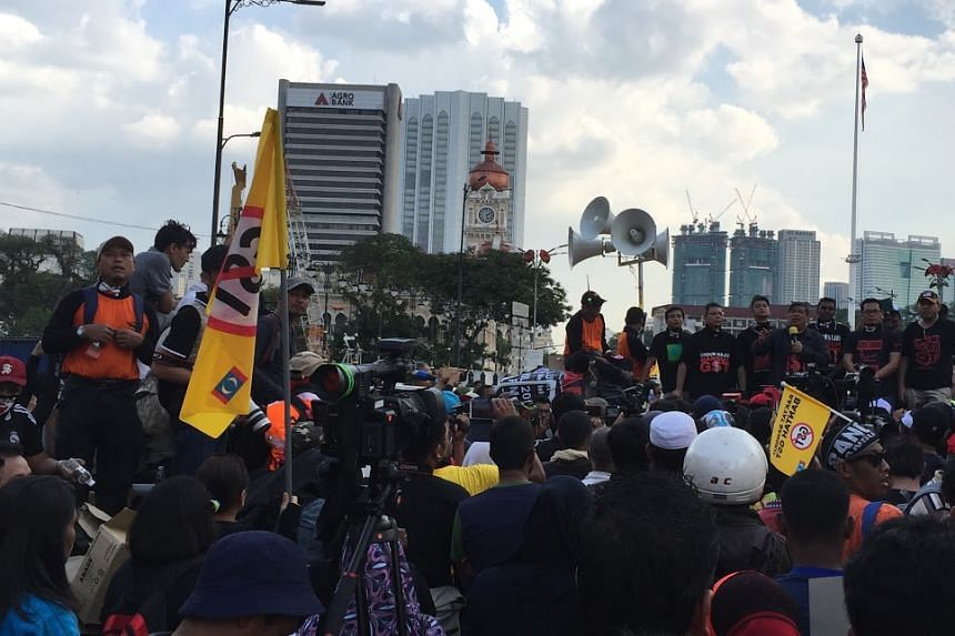 More than 2,000 protesters braved Kuala Lumpur's scorching heat on Saturday afternoon.