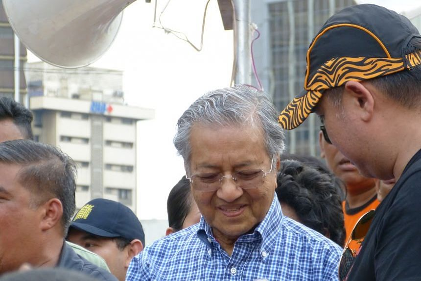 """Former premier Mahathir Mohamad pleaded with the crowd to join other prominent signatories of the so-called """"Citizens' Declaration""""."""