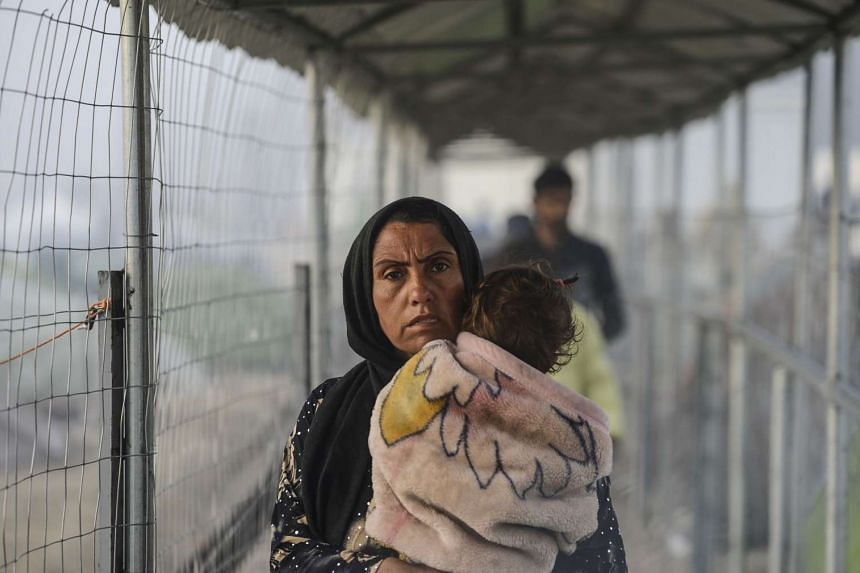 A woman and child at a makeshift camp in Greece on April 1, 2016.