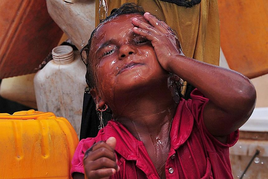 A Yemeni girl washing her face at the UNHCR Obock refugee camp in Djibouti on March 26.