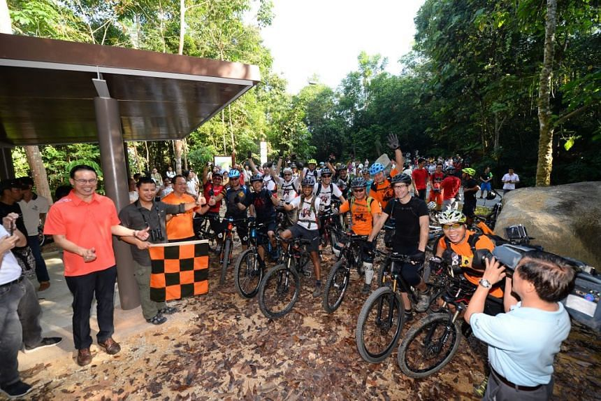 Senior Minister of State Desmond Lee, Mayor Dr Teo Ho Pin and MP Liang Eng Hwa flagging off mountain bikers at Chestnut Nature Park (South).