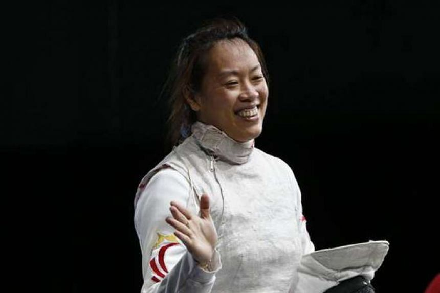 An elated Wang Wenying after winning gold at the 2014 Commonwealth Fencing Championships. She would have preferred to compete in more overseas events but nevertheless is pleased with her fitness ahead of the Olympic zonal qualifier.