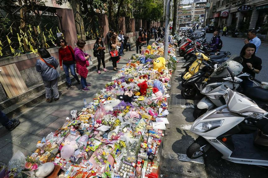 A makeshift memorial at a street next to the scene where a four-year-old girl was killed earlier this week, in Taipei, on March 29.