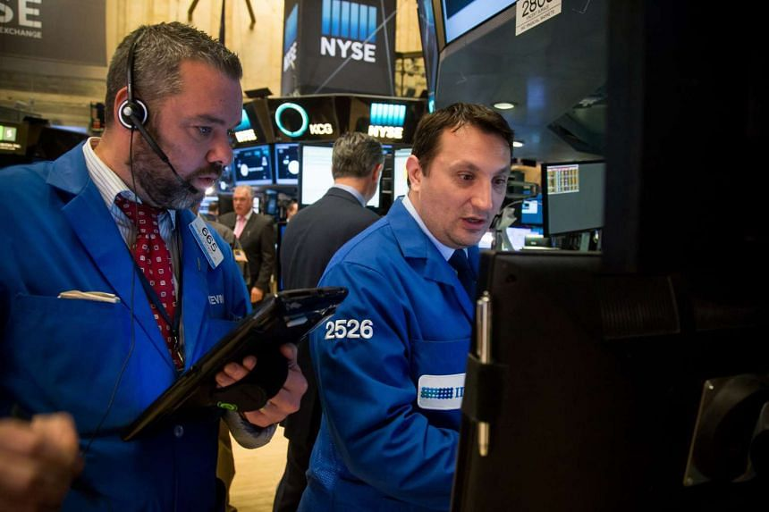 Traders work on the floor of the New York Stock Exchange on Friday, April 1, 2016.