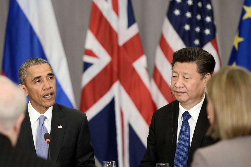 Chinese President Xi Jinping (right) and US President Barack Obama during the Nuclear Security Summit in Washington, DC, on April 1.
