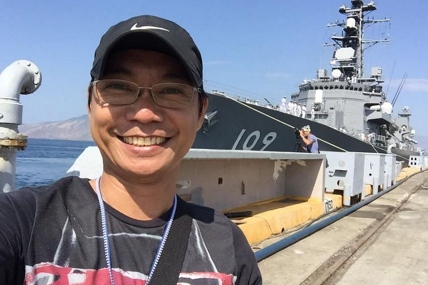 "The Straits Times' Philippines Correspondent Raul Dancel with Japan's Murasame-class JS Ariake, which docked at the Philippines' Subic Bay on April 3, 2016. It is one of two destroyers escorting the submarine Oyashio ahead of three-day ""training exer"