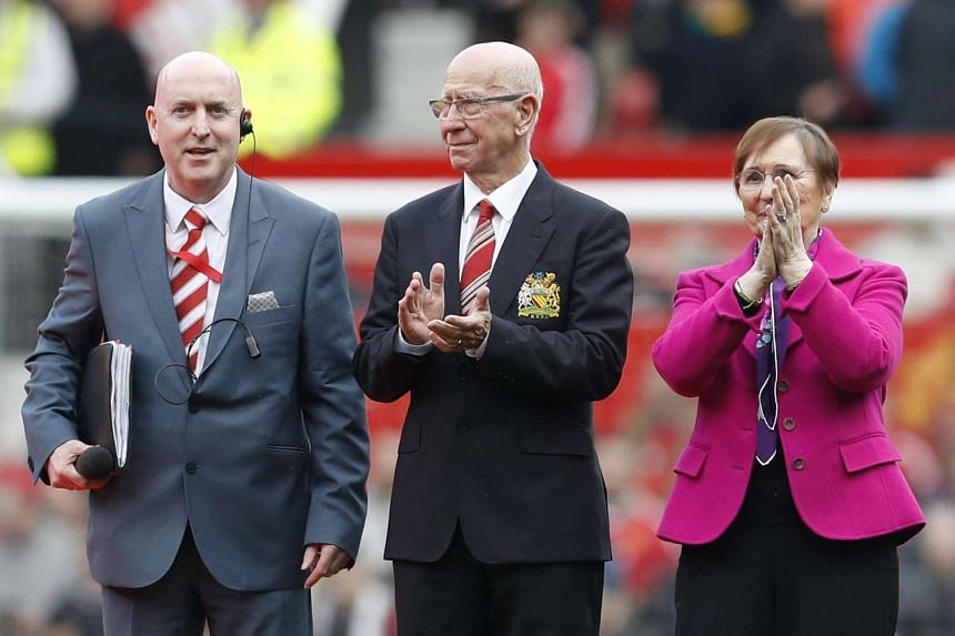 "Sir Bobby Charlton and wife Norma applaud fans as the newly renamed South Stand ""Sir Bobby Charlton stand"" was unveiled to mark the 60th anniversary of his debut for Manchester United."