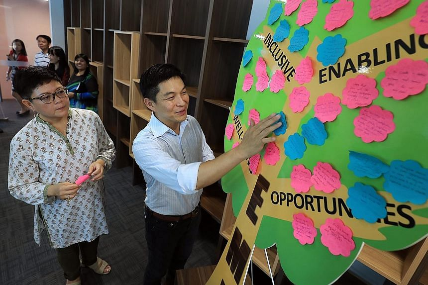 Minister for Social and Family Development Tan Chuan-Jin with Ms Anita Fam, who chairs the 22-member committee for the third Enabling Masterplan.
