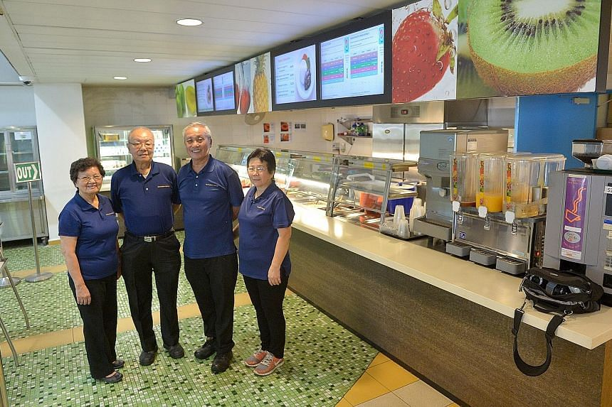 For half a century, Mr Hoe Juan Jok, 68 (second from right) has kept the running of the SAS' cafeterias in the family, including (from left) his sister Hoo Juan Ang, his brother Hoe Juan Sim and his wife Chua Kim Lan. And they have no intention to re