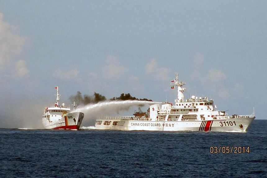A Chinese vessel (right) using a water cannon on a Vietnamese vessel near the Paracel islands in May 2014. Chinese boats reportedly rammed Vietnamese vessels near disputed waters where China had stationed an oil drilling platform. Fish produce at a m