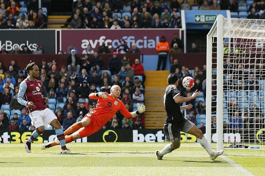 Aston Villa goalkeeper Brad Guzan flapping the ball into the path of Pedro Rodriguez (right), who shoots into an empty net from a narrow angle for Chelsea's fourth goal.