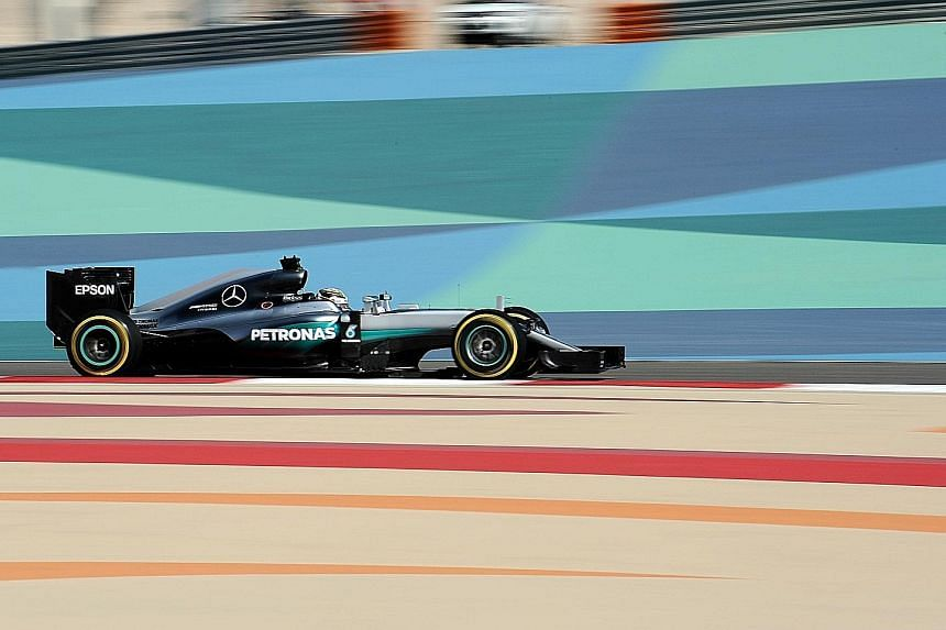 Triple world champion Lewis Hamilton took the 51st lap of his career, holding out team-mate and Australian Grand Prix winner Nico Rosberg.
