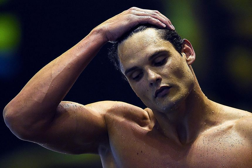 Florent Manaudou looking downcast after finishing third in the 100m free final at the French swimming championships on Friday.