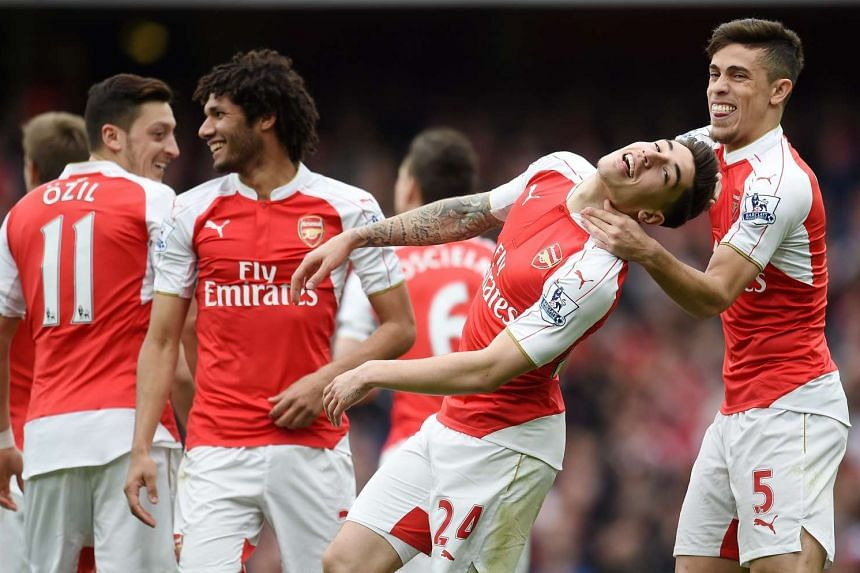 Arsenal's Hector Bellerin (second right) celebrates with team mate Gabriel (right) after scoring against Watford.
