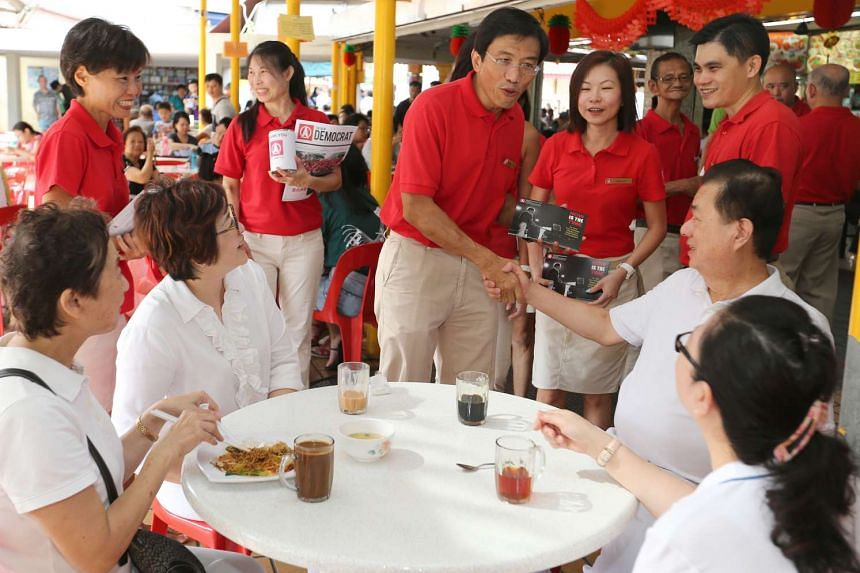 Dr Chee shaking hands with a resident during his walkabout.