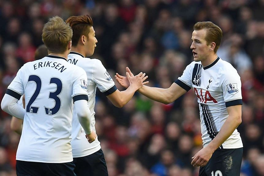 Kane (right) celebrates with Tottenham Hotspur's South Korean striker Son Heung-Min after scoring thier first goal.