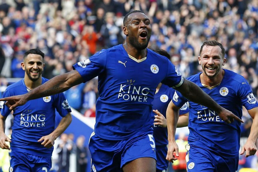 Leicester City captain Wes Morgan is pursued by joyous teammates after his headed goal against Southampton.